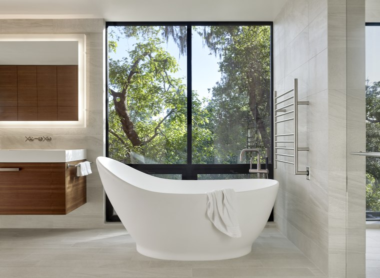Positioned so the occupant can enjoy the wooded architecture, bathroom, freestanding bathtub, floor, home, house, interior design, plumbing fixture, tap, tile,