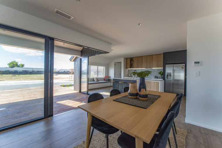 ​​​​​​​In this Fowler Homes Waikato showhome corner sliders apartment, architecture, building, ceiling, daylighting, dining room, estate, floor, flooring, furniture, hardwood, home, house, interior design, laminate flooring, property, real estate, residential area, room, table, window, wood, wood flooring, gray