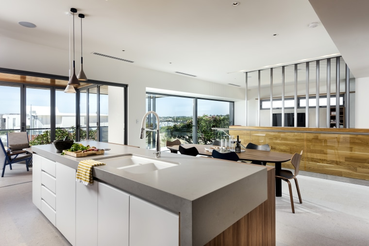 ​​​​​​​Kitchen with quite a view – this kitchen's architecture, black-and-white, cabinetry, countertop, benchtop, design, floor, flooring, furniture, kitchen, lighting, gray, Ceasarstone, tap, Nadia Clark, Riverstone Custom Homes