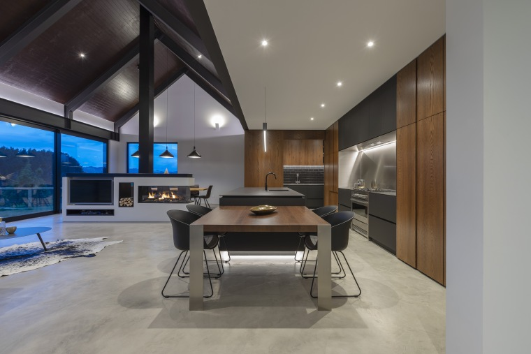 While this kitchen needed to tie in with apartment, architecture, building, ceiling, design, cabinetry, kitchen, dining room, floor, flooring, furniture, home, house, interior design, lighting, living room, loft, property, real estate, room, table, wall, gray