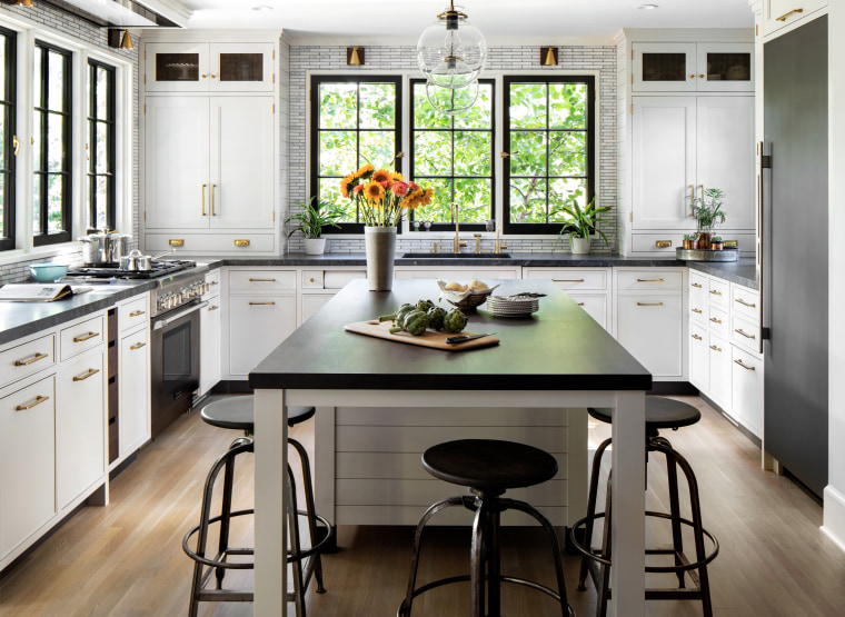 This kitchen reflects a rich materiality, with touches bar stool, cabinetry, ceiling, countertop, dining room, floor, timber flooring, furniture, home, house, interior design, kitchen, kitchen stove, stool, table, wood flooring, Studio Dearborn
