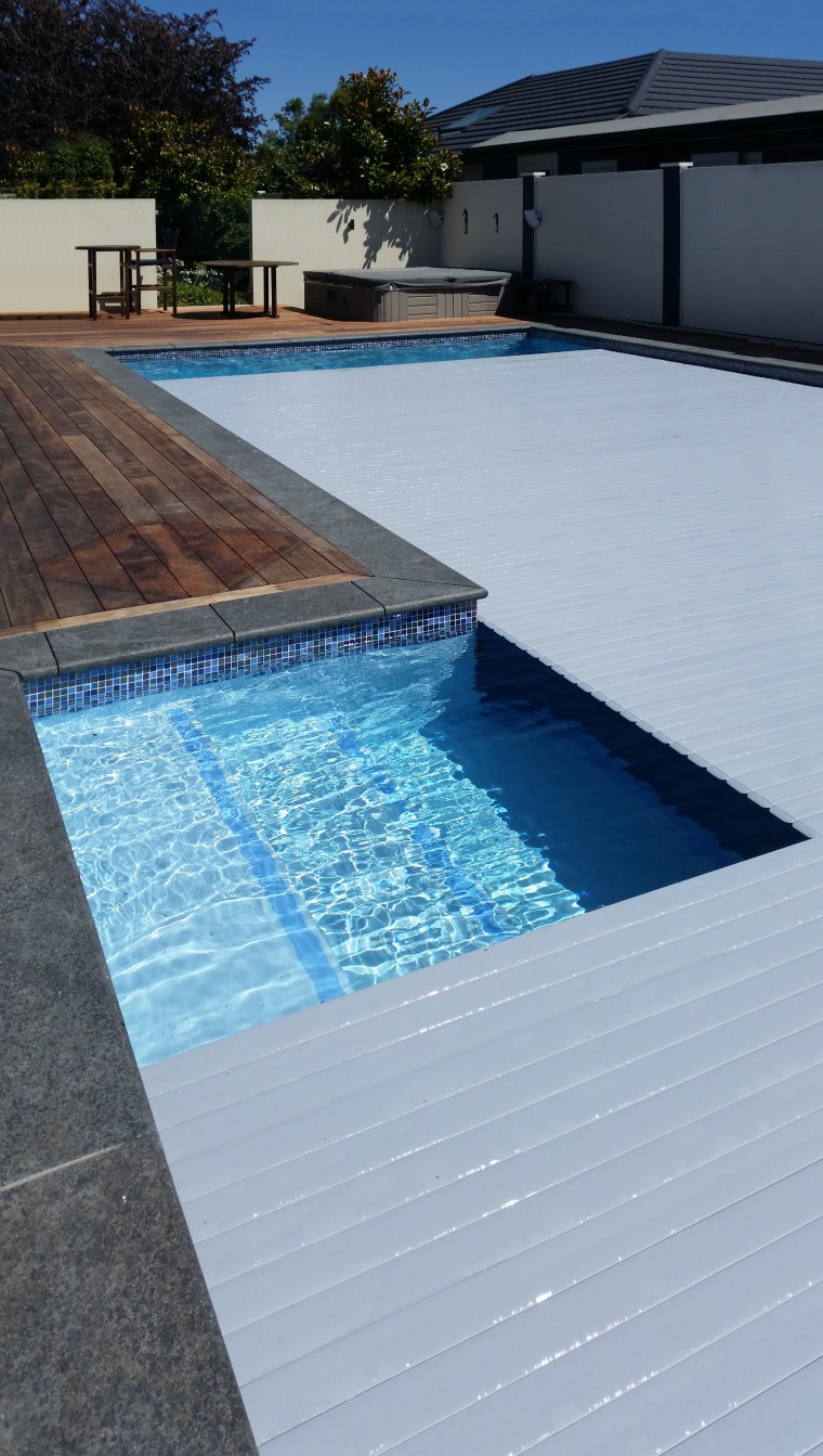 Roll Out Roll Under slatted covers are a architecture, composite material, floor, leisure, property, real estate, rectangle, swimming pool, tile, water, water feature, gray