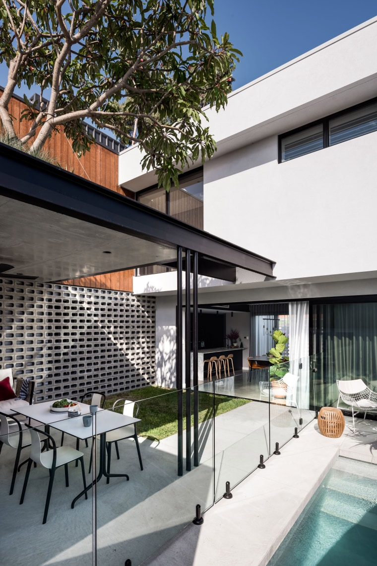 ​​​​​​​On this green-focussed home, pulling the covered alfresco apartment, architecture, backyard, building, ceiling, condominium, courtyard, design, facade, furniture, home, house, interior design, material property, patio, property, real estate, residential area, roof, room, shade, gray, white, breeze block