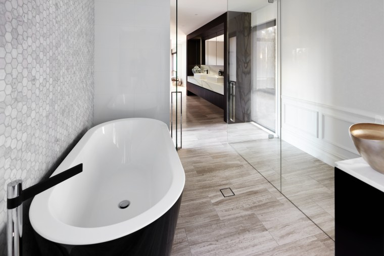 ​​​​​​​This long bathroom combines classic surfaces such as architecture, bathroom, bathtub, bidet, ceramic, plumbing fixture, property, tap, moasaic tile, toilet, Archer Design