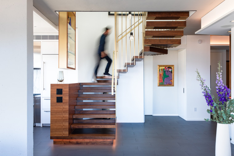 ​​​​​​​Reconfiguring the stairs was a major  contributor to architecture, building, ceiling, floor, flooring, furniture, hall, hardwood, home, house, interior design, loft, room, stairs, wood, white