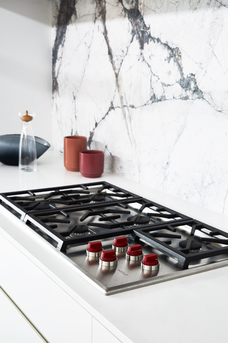 ​​​​​​​Appliances that are on display in this kitchen cooktop, countertop, furniture, gas, gas stove, interior design, kitchen, material property, room, table, tile, white
