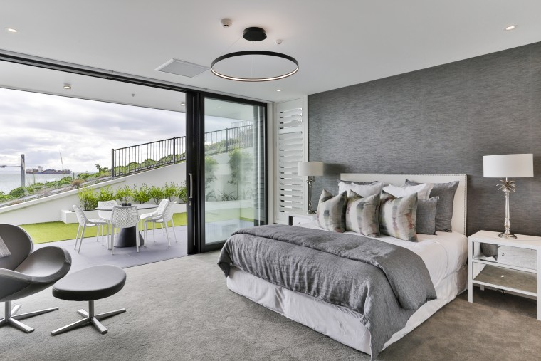 ​​​​​​​Large sliders between this master bedroom and terrace architecture, bed, bed frame, bed sheet, bedding, bedroom, black-and-white, building, ceiling, design, floor, flooring, furniture, home, house, interior design, property, real estate, room, suite, wall, gray