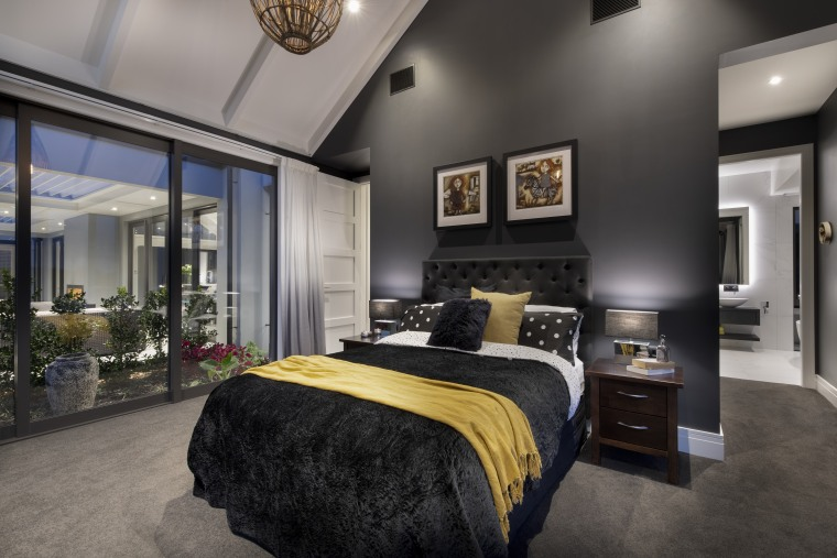 This large master suite includes a glass-walled bedroom, black, gray