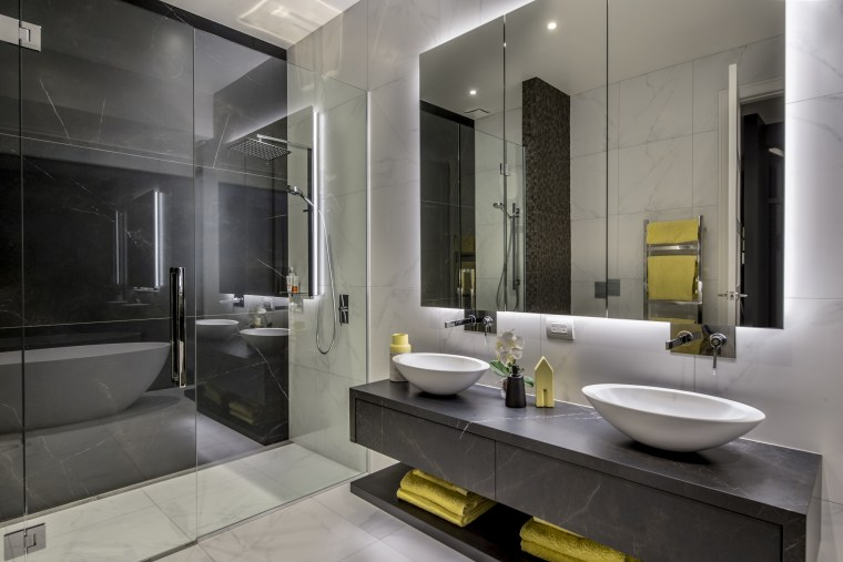 With a dark wall behind, the shower glass gray, black