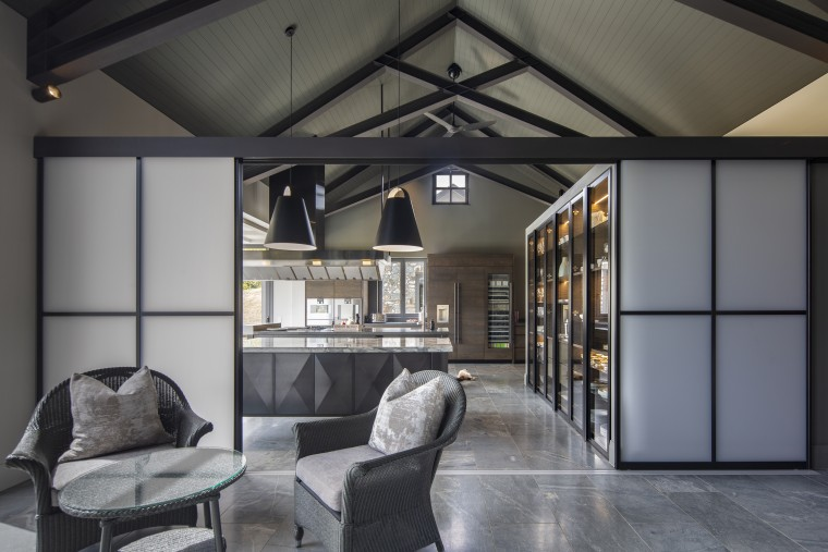 Japanese-look screens part to reveal this industrial-look kitchen gray, black