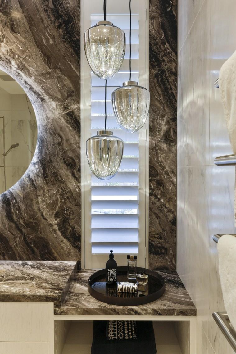 In this powder room, by designer Jennie Dunlop, gray
