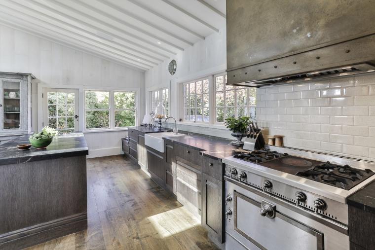 This kitchen's darker tones make perfect sense within gray