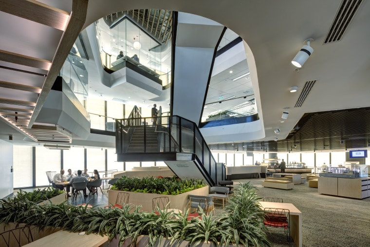 The light-filled Town Hall space on the mid architecture, building, ceiling, convention center, daylighting, design, headquarters, interior design, lobby, mixed-use, real estate, shopping mall, gray