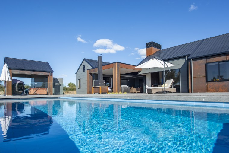 The Resort by Fowler Homes features Corten steel architecture, building, estate, home, house, leisure, leisure centre, property, real estate, residential area, resort, resort town, swimming pool, vacation, villa, teal