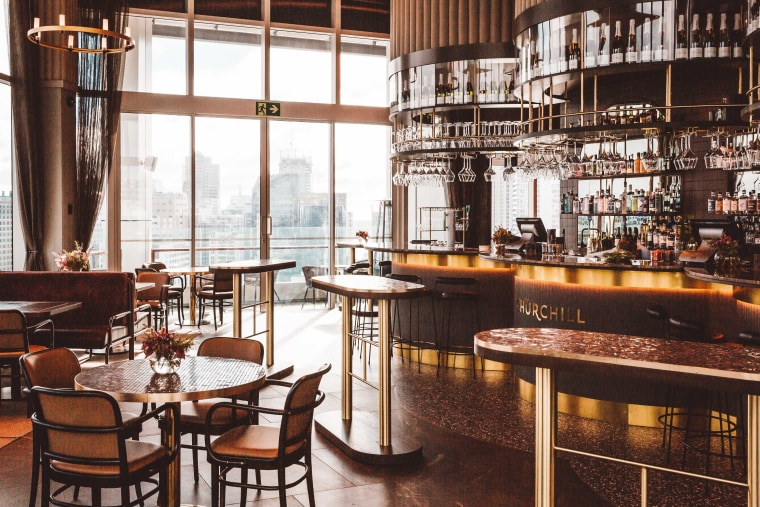Pride of place – The Churchill occupies part architecture, bar, building, coffeehouse, furniture, interior design, restaurant, room, table, black, white