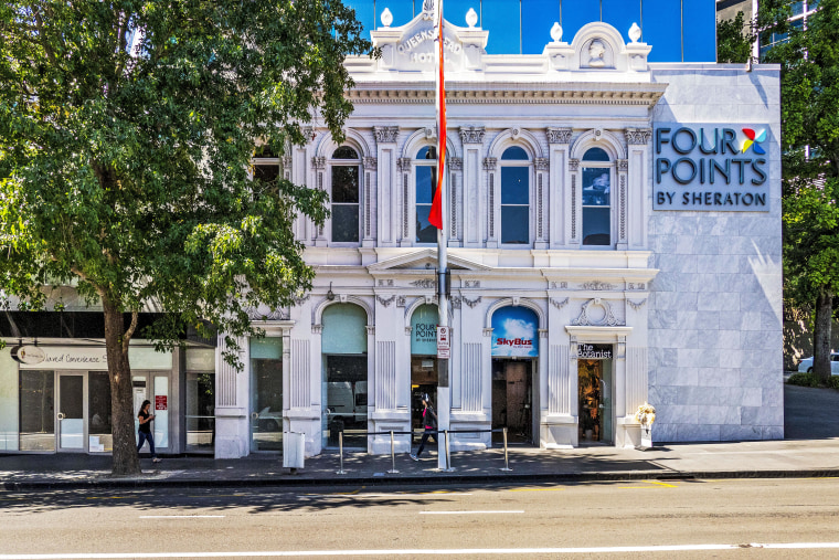 The façade of the original Queen's Head pub architecture, building, city, downtown, facade, home, house, landmark, neighbourhood, property, real estate, street, town, tree, gray