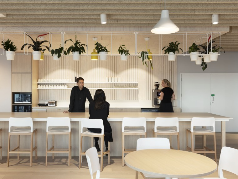 The Mercury fit-out's cafe-style kitchen has views to building, ceiling, design, dining room, flooring, furniture, interior design, lighting, restaurant, room, table, wallpaper, gray