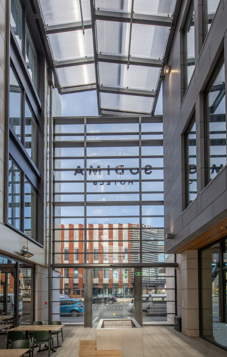 The Sudima Laneway atrium's two-canopy system keeps the architecture, building, ceiling, city, commercial building, daylighting, interior design, mixed-use, window, gray, black