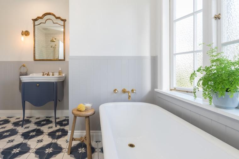 The room has both a masculine and feminine architecture, bathroom, bathtub, building, estate, floor, flooring, furniture, home, house, interior design, property, real estate, room, tap, tile, white, masculine, feminine