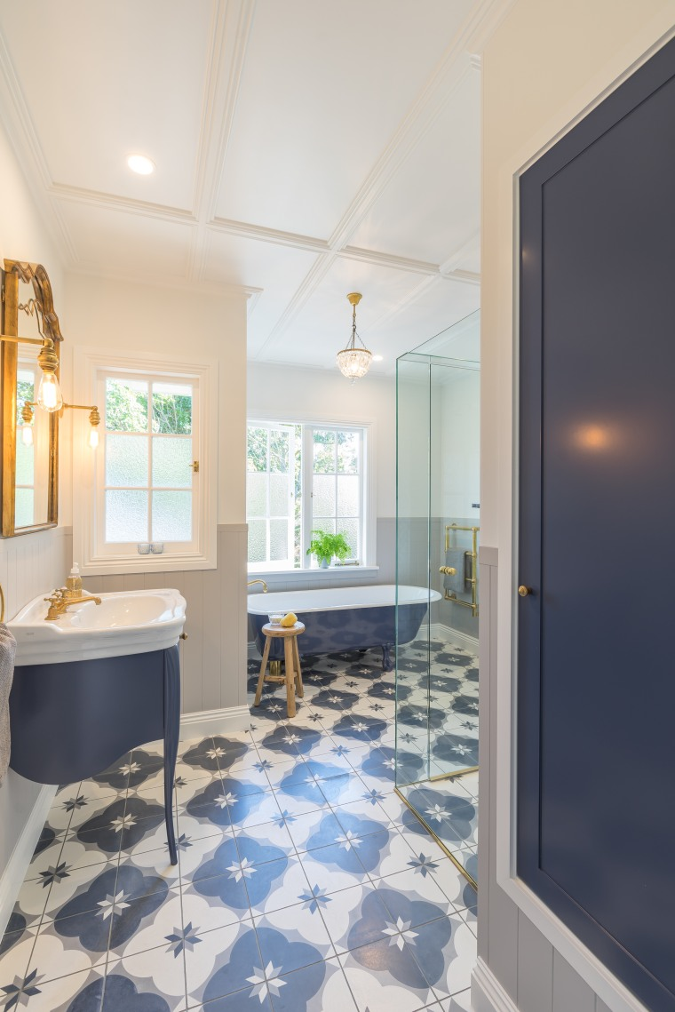 In this bathroom renovation for a brother and apartment, architecture, bathroom, building, ceiling, daylighting, estate, floor, flooring, furniture, home, house, interior design, property, real estate, room, tile, yellow, gray, floor, flooring, tile flooring