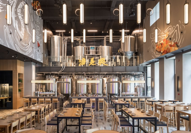 With its grand 10m-high ceiling, the double-height brewery architecture, building, cafeteria, ceiling, furniture, interior design, restaurant, room, black
