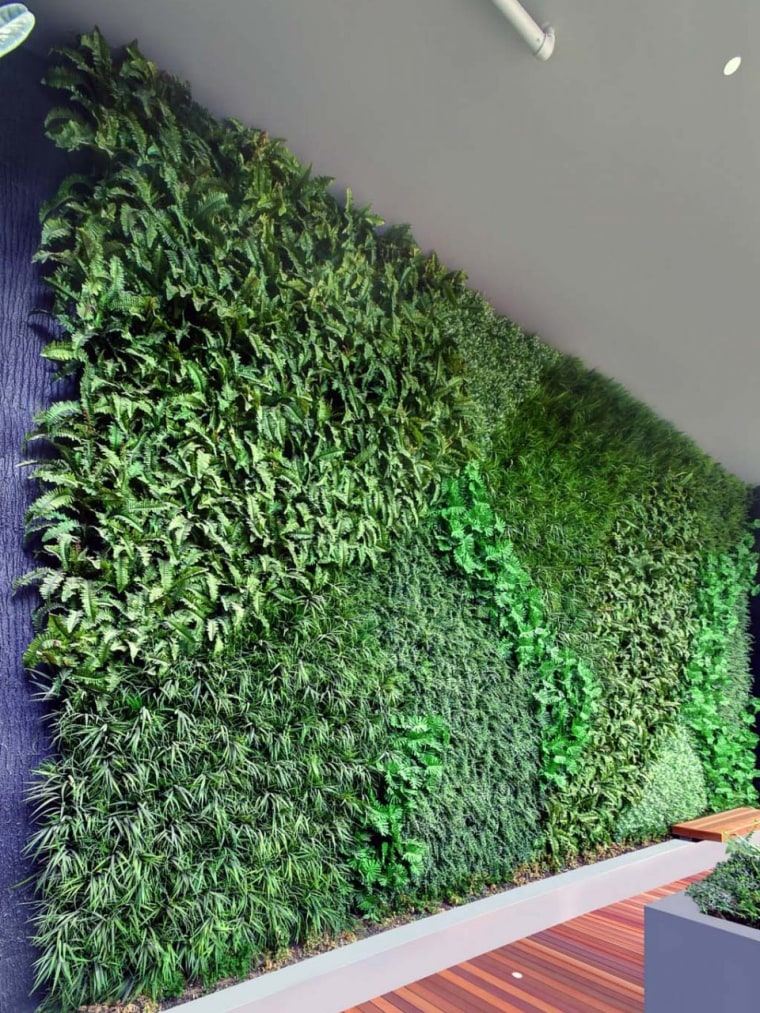 This Outdoor Feature Wall by Green Turf grass, hedge, plant, shrub, green