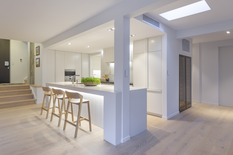 One of the challenges was to ensure the apartment, architecture, building, ceiling, daylighting, floor, flooring, furniture, hardwood, home, house, interior design, kitchen, loft, property, real estate, room, table, wood, wood flooring, gray