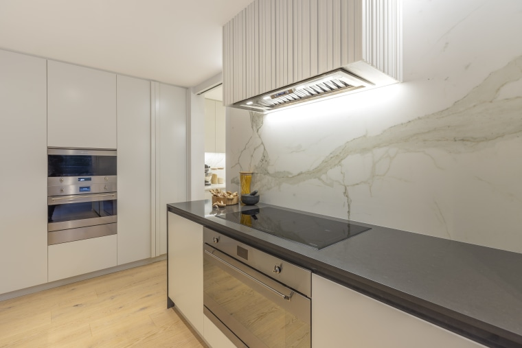 The entire island and rangehood housing are made architecture, building, cabinetry, ceiling, countertop, cupboard, floor, furniture, house, interior design, kitchen, material property, property, real estate, room, yellow, gray