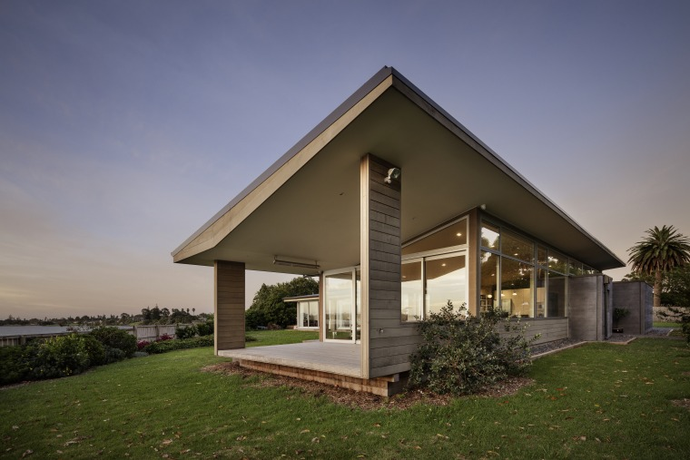 Functionally, the roof extends beyond the concrete boxes, architecture, building, cottage, estate, facade, farmhouse, grass, home, house, land lot, landscape, property, real estate, residential area, roof, room, rural area, siding, sky, tree, villa, brown, blue