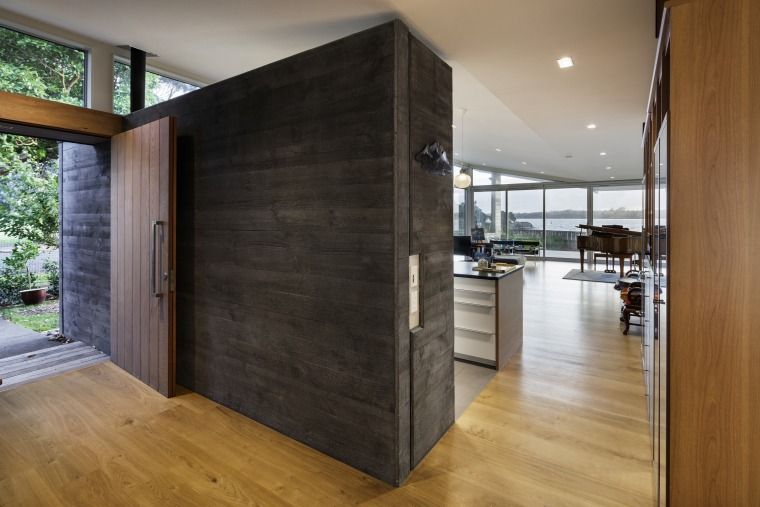 Concrete board textured panels wrap from the outside architecture, auto part, automotive exterior, building, cabinetry, ceiling, door, facade, floor, flooring, furniture, glass, hall, hardwood, home, house, interior design, laminate flooring, loft, plywood, property, real estate, room, vehicle door, wall, wood, wood flooring, black, brown, gray