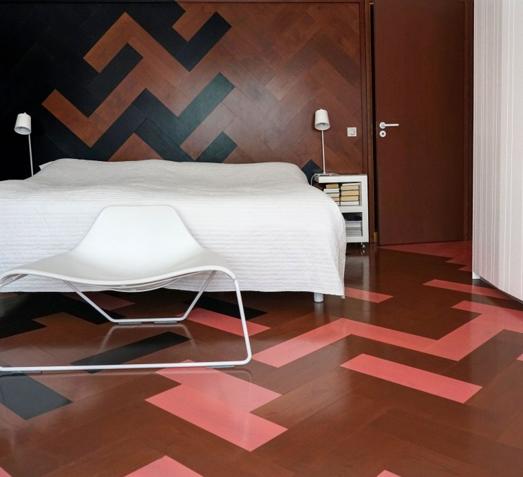 Technicolour parquet flooring makes a dramatic impact in architecture, bed, bed sheet, bedroom, building, design, floor, flooring, furniture, hardwood, house, interior design, laminate flooring, material property, room, tile, wall, wood, wood flooring, red