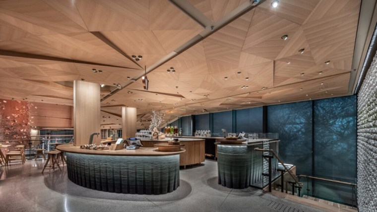 The stunning wood-tiled ceiling was inspired by the architecture, beam, building, ceiling, design, floor, flooring, furniture, home, house, interior design, lighting, real estate, restaurant, room, brown