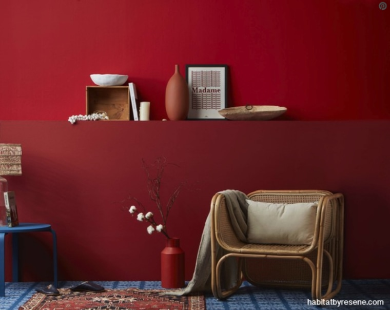 Two uplifting and cheerful reds have been cleverly furniture, interior design, red, room, shelf, shelving, table, wall, red