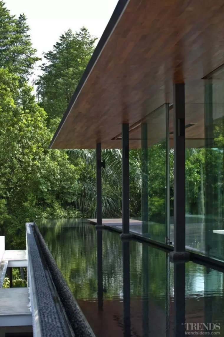 Ripples on the water enliven the interior spaces. architecture, building, cottage, home, house, pavilion, porch, property, real estate, room, shade, tree, window, black, green