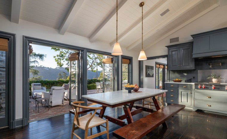 Step inside Jodie Foster's Beverly Hills home - architecture, building, ceiling, countertop, daylighting, dining room, estate, floor, flooring, furniture, hardwood, home, house, interior design, kitchen, loft, property, real estate, room, table, window, wood flooring, gray, black