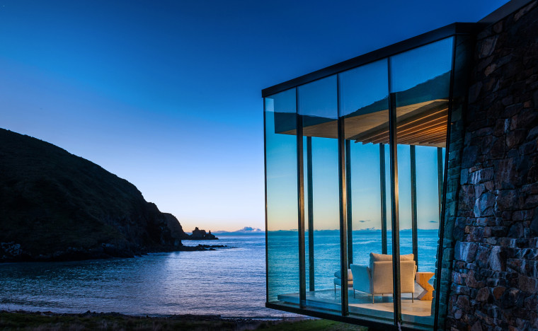 One of the newest additions to the luxury architecture, azure, blue, building, evening, glass, horizon, house, ocean, rock, room, sea, sky, water, window, black, blue
