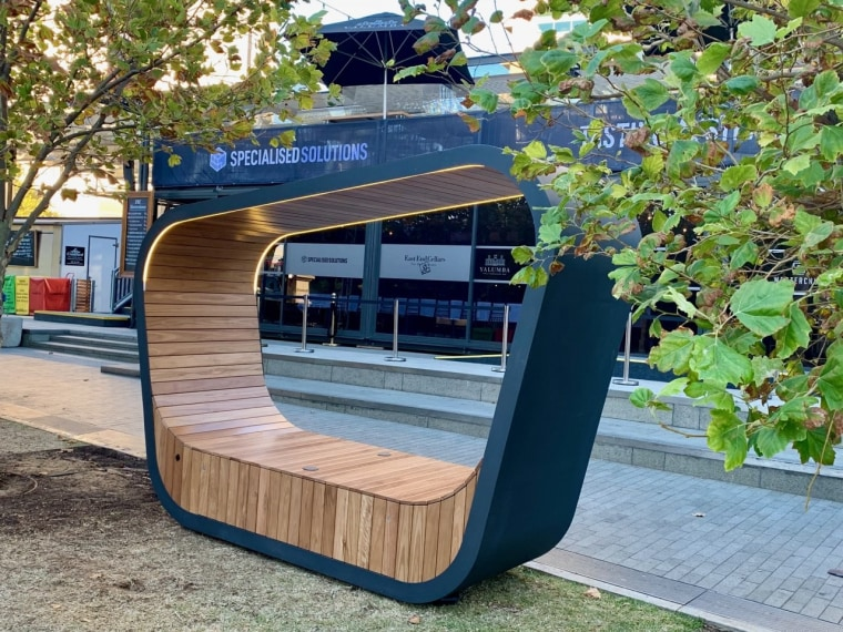 Timber lined and steel framed, the Sedi Connect architecture, bus stop, furniture, public space, swing, tram, transport, tree, vehicle, gray