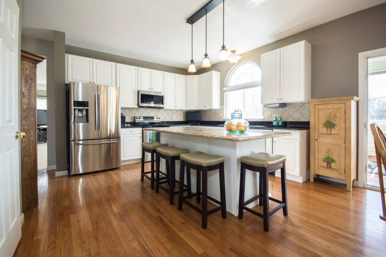The kitchen floor is one of the most cabinetry, countertop, cuisine classique, floor, flooring, hardwood, interior design, kitchen, laminate flooring, real estate, room, wood, wood flooring, white