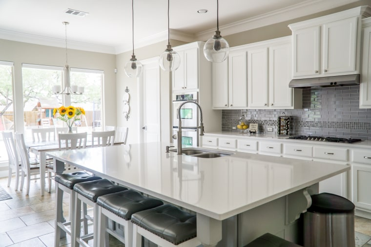 Photo by Mark McCammon from Pixels architecture, building, cabinetry, ceiling, countertop, cuisine classique, floor, flooring, furniture, granite, home, house, interior design, kitchen, material property, property, room, table, tile, yellow, white