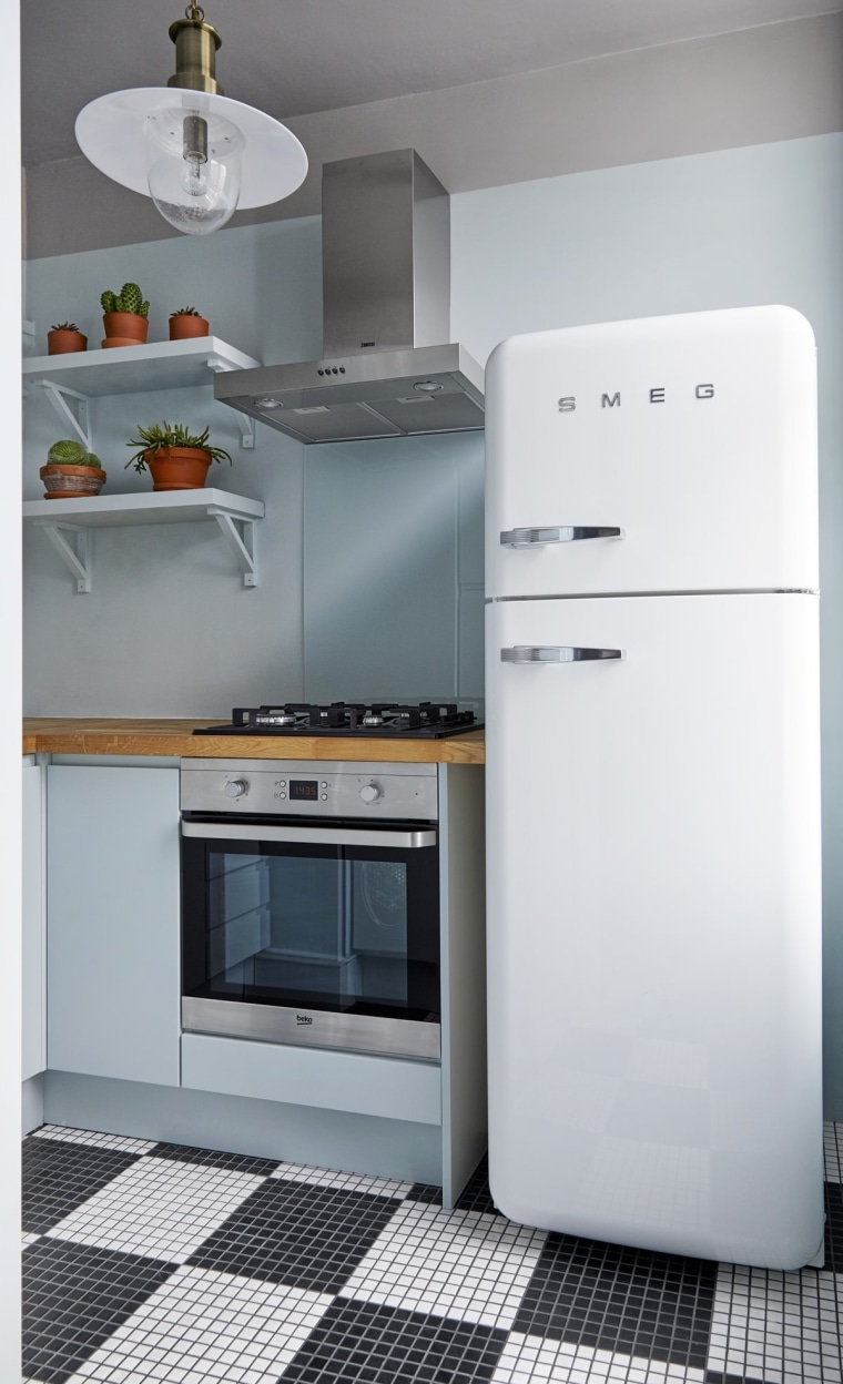 Saving space is essential in apartments – especially gas stove, home appliance, kitchen, kitchen appliance, kitchen stove, major appliance, microwave oven, product, product design, refrigerator, small appliance, gray, white