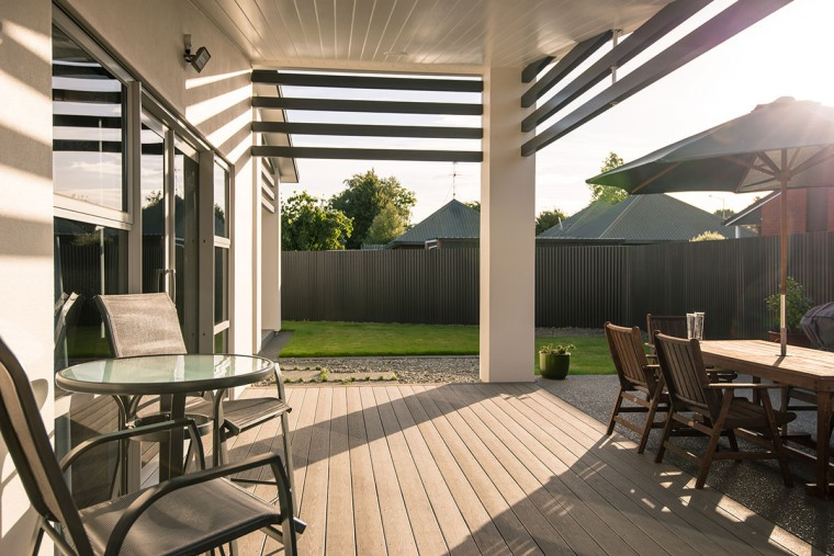 A superb TimberTech Silver Maple deck house, interior design, outdoor structure, patio, real estate, roof, black