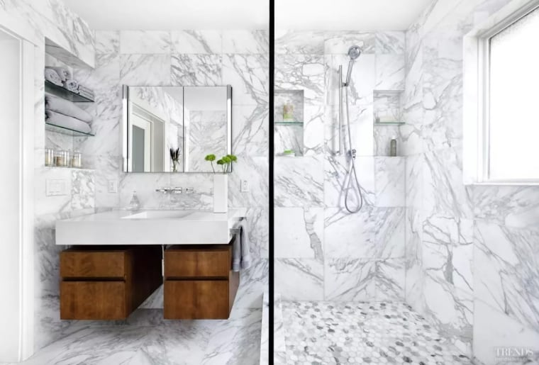 Avoid transitions to make a space feel larger bathroom, bathroom accessory, bathroom cabinet, black and white, floor, furniture, home, interior design, plumbing fixture, product design, room, sink, wall, white