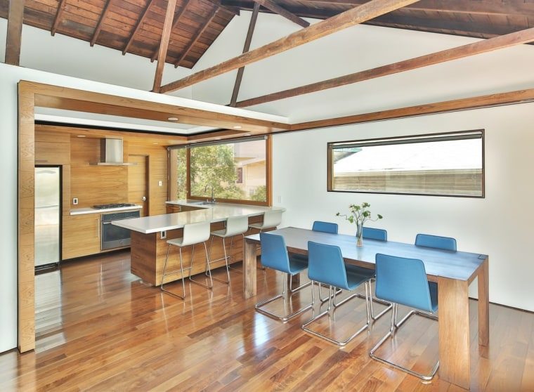 An exposed ceiling with gables opens up the architecture, beam, ceiling, daylighting, dining room, floor, flooring, hardwood, house, interior design, loft, real estate, table, wood, wood flooring, white, orange