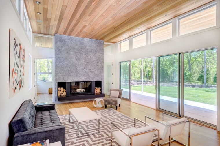 The fireplace is the centre of the open architecture, ceiling, daylighting, estate, floor, home, house, interior design, living room, property, real estate, window, gray