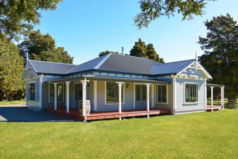 At a classic style Envira weatherboard house. cottage, elevation, estate, facade, farmhouse, home, house, property, real estate, siding