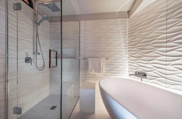 Distinctive 3D wave-pattern tiles running behind the tub architecture, bathroom, ceiling, floor, flooring, interior design, room, tile, wall, gray