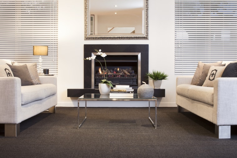 The Australian Carpet Classification Scheme (ACCS) is the coffee table, couch, fireplace, floor, flooring, furniture, hardwood, hearth, home, interior design, laminate flooring, living room, loveseat, table, wood flooring, white