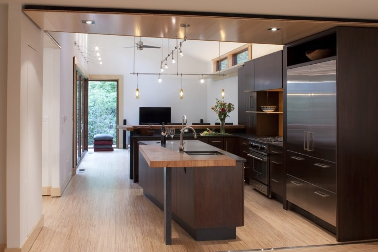 Every effort was made to make the new cabinetry, countertop, cuisine classique, floor, flooring, hardwood, interior design, kitchen, room, wood flooring, gray, black