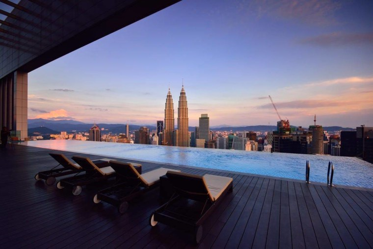 Infinity pools offer unparalleled luxury architecture, building, city, cityscape, condominium, downtown, dusk, evening, horizon, hotel, real estate, reflection, roof, sea, sky, skyline, skyscraper, sunset, water, purple, blue
