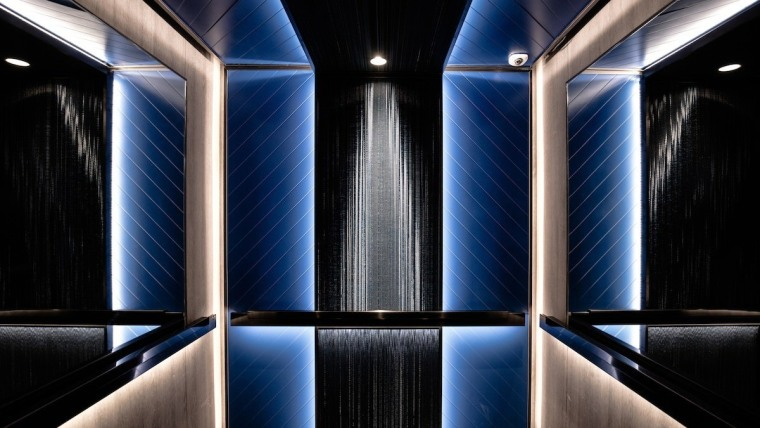 It's a true celebration of Art Deco architecture, light, lighting, symmetry, black, blue